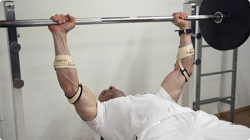 The Masalo brace used by Tamer Galal, Mr. Universe 2004 and professional bodybuilder performing bench press